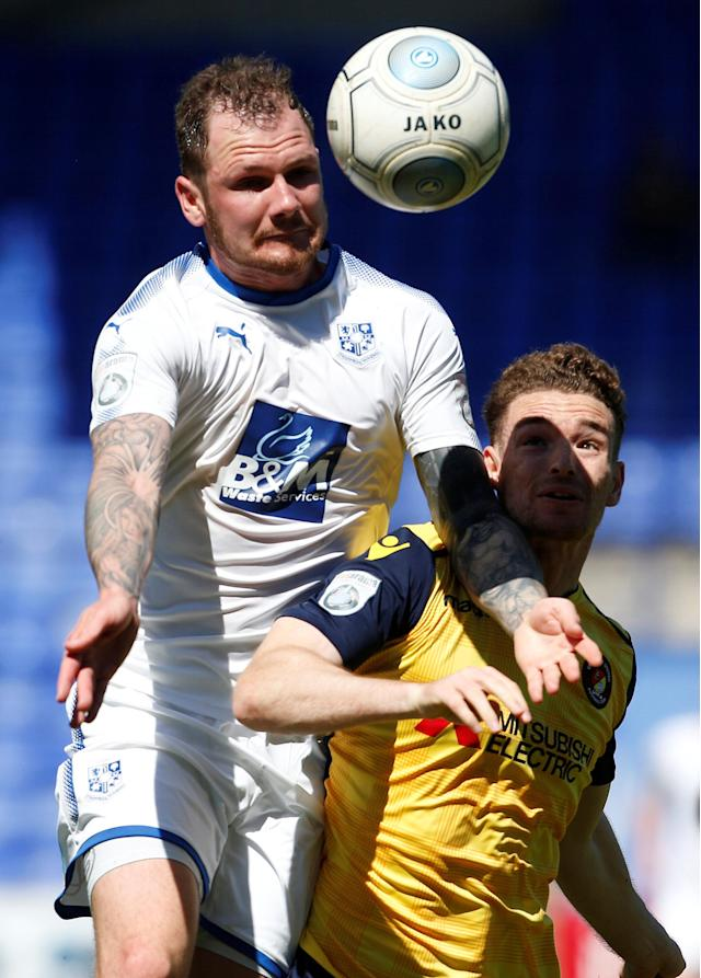 "Soccer Football - National League Play-Off Semi Final - Tranmere Rovers vs Ebbsfleet United - Prenton Park, Birkenhead, Britain - May 5, 2018 Tranmere Rovers' James Norwood (L) in action with Ebbsfleet United's Jack Connors Action Images/Craig Brough EDITORIAL USE ONLY. No use with unauthorized audio, video, data, fixture lists, club/league logos or ""live"" services. Online in-match use limited to 75 images, no video emulation. No use in betting, games or single club/league/player publications. Please contact your account representative for further details."