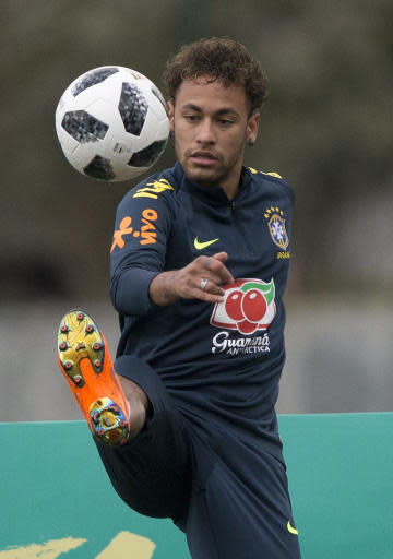 Brazil's Neymar controls the ball during a practice session of the Brazilian national soccer team ahead the World Cup in Russia, at the Granja Comary training center in Teresopolis, Brazil, Thursday, May 24, 2018. (AP Photo/Silvia Izquierdo)