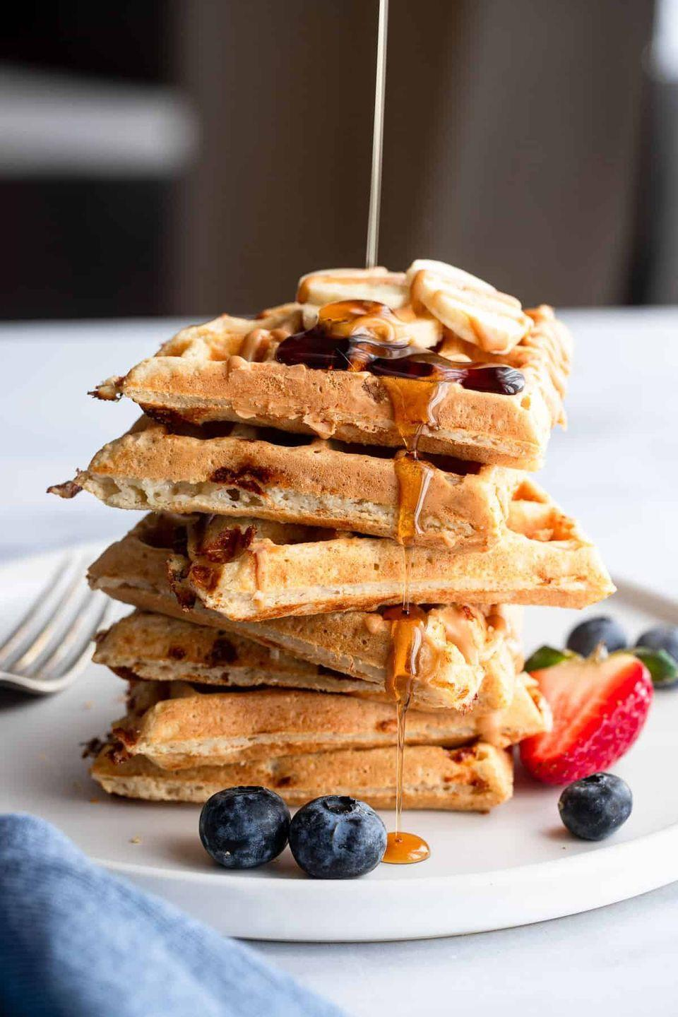 """<p>There are two secret ingredients in these power-packed waffles: protein powder and cottage cheese. The protein powder keeps you full and gives you a boost of energy, while the cottage cheese ensures the waffles don't dry out.</p><p><strong>Get the recipe at <a href=""""https://www.foodfaithfitness.com/protein-waffles/"""" rel=""""nofollow noopener"""" target=""""_blank"""" data-ylk=""""slk:Food Faith Fitness"""" class=""""link rapid-noclick-resp"""">Food Faith Fitness</a>.</strong></p><p><strong><a class=""""link rapid-noclick-resp"""" href=""""https://go.redirectingat.com?id=74968X1596630&url=https%3A%2F%2Fwww.walmart.com%2Fsearch%2F%3Fquery%3Dwaffle%2Bmaker&sref=https%3A%2F%2Fwww.thepioneerwoman.com%2Ffood-cooking%2Fmeals-menus%2Fg34922086%2Fhealthy-breakfast-ideas%2F"""" rel=""""nofollow noopener"""" target=""""_blank"""" data-ylk=""""slk:SHOP WAFFLE MAKERS"""">SHOP WAFFLE MAKERS</a><br></strong></p>"""