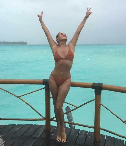 """<p>A rainy day in Tahiti is better than a sunny day anywhere else. The 52-year-old <i>Housewives</i> alum, and mama to Gigi and Bella, reminds us of her model roots. (Photo: <a href=""""https://www.instagram.com/p/BGVRzs2osw7/?taken-by=yolanda.hadid&hl=en"""" rel=""""nofollow noopener"""" target=""""_blank"""" data-ylk=""""slk:Instagram"""" class=""""link rapid-noclick-resp"""">Instagram</a>) </p>"""