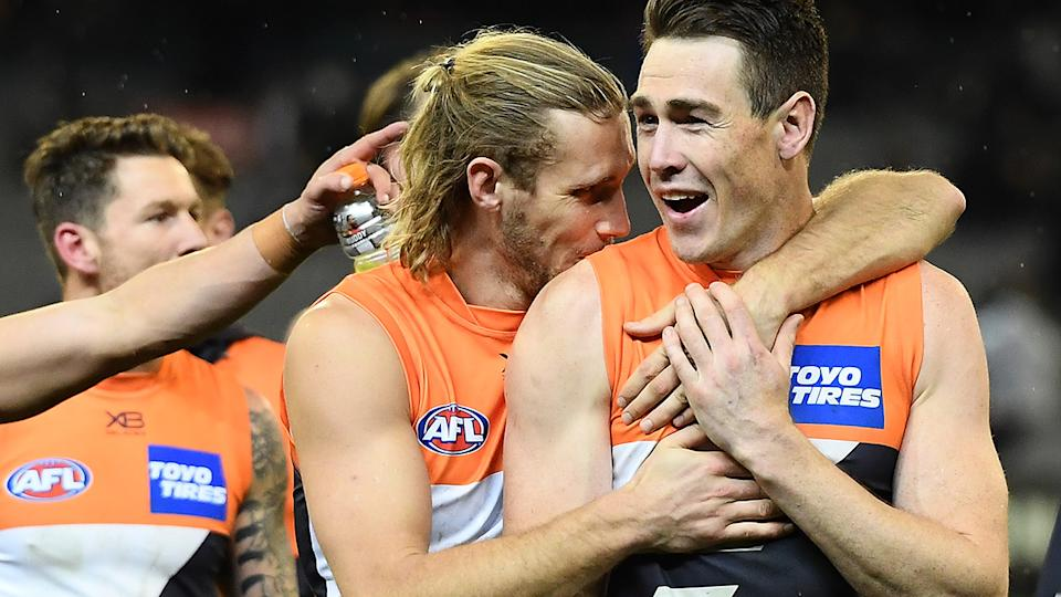 Jeremy Cameron is pictured with GWS Giants teammate Nick Haynes.