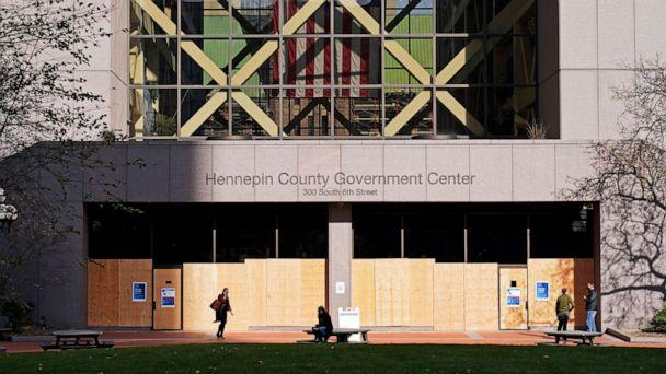 PHOTO: The Government Center, though open for business, remains boarded up, Nov. 2, 2020, in Minneapolis ahead of Tuesday's general election. (Jim Mone/AP)