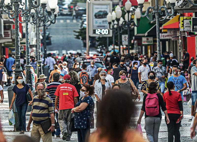 View of a crowded street in Florianopolis, Santa Catarina state, Brazil, on May 12, 2020 amid the Covid-19 coronavirus pandemic. - President Jair Bolsonaro's criticism of stay-at-home measures to fight the virus has put him at odds with state and local authorities across Brazil whom insist the danger is all too real. Meanwhile, Brazil has emerged as the epicenter of the pandemic in Latin America, with 11,519 deaths so far. (Photo by EDUARDO VALENTE / AFP) (Photo by EDUARDO VALENTE/AFP via Getty Images)