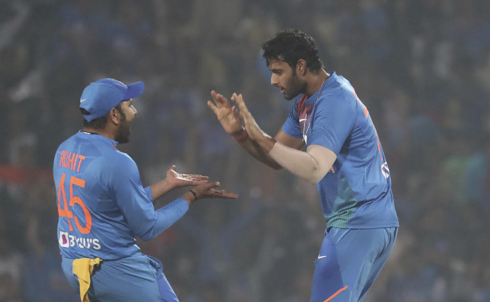 Indian players Shivam Dube, right, with Rohit Sharma celebrate the wicket of Bangladesh's Mushfiqur Rahim during their third Twenty20 international cricket match against India in Nagpur, India, Sunday, Nov. 10, 2019.(AP Photo/Rafiq Maqbool)