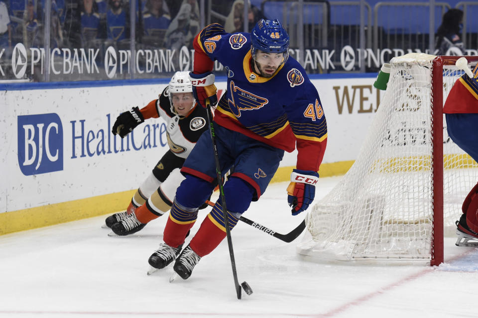 Anaheim Ducks' Isac Lundestrom (48) pressures St. Louis Blues' Jake Walman (46) during the first period of an NHL hockey game on Wednesday, May 5, 2021, in St. Louis. (AP Photo/Joe Puetz)