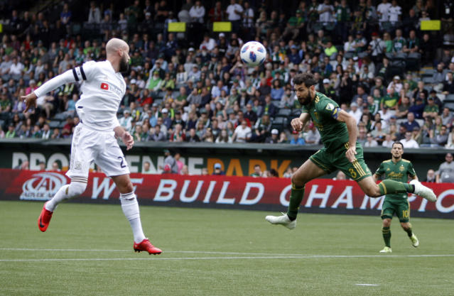 Portland Timbers' Diego Valeri (8) tries a header against LAFC during an MLS soccer game, Saturday, May 19, 2018, in in Portland, Ore. (Sean Meagher//The Oregonian via AP)