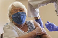 Nathalie Avery, 90, reacts as she gets the COVID-19 vaccine, Thursday, Jan. 21, 2021, at the Isles of Vero Beach assisted and independent senior living community in Vero Beach, Fla. As of Thursday, Jan. 28, 2021, 3.1 million doses have been given in long-term care facilities, according to the Centers for Disease Control and Prevention. That's about 30% of the roughly 10 million vaccines that David Grabowski, a health policy professor at Harvard Medical School, estimates will be needed to fully protect residents and employees. (AP Photo/Wilfredo Lee)