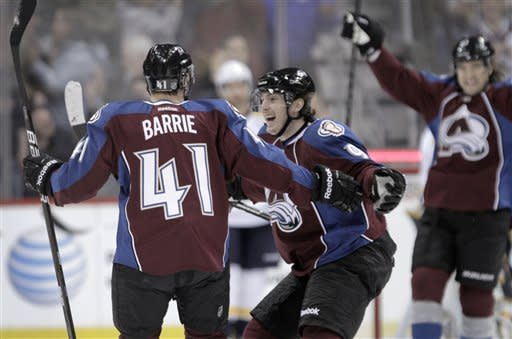 Colorado Avalanche center Matt Duchene (9) celebrates a goal by Avalanche defenseman Tyson Barrie (41) against the Nashville Predators during the first period of an NHL hockey game, Monday, Feb. 18, 2013, in Denver. Duchene assisted on the goal.(AP Photo/Joe Mahoney)