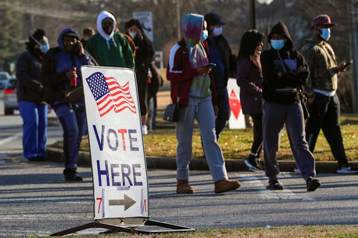 <p>Voters stand in line during Georgia's US Senate run-off election on 5 January.</p> (REUTERS)