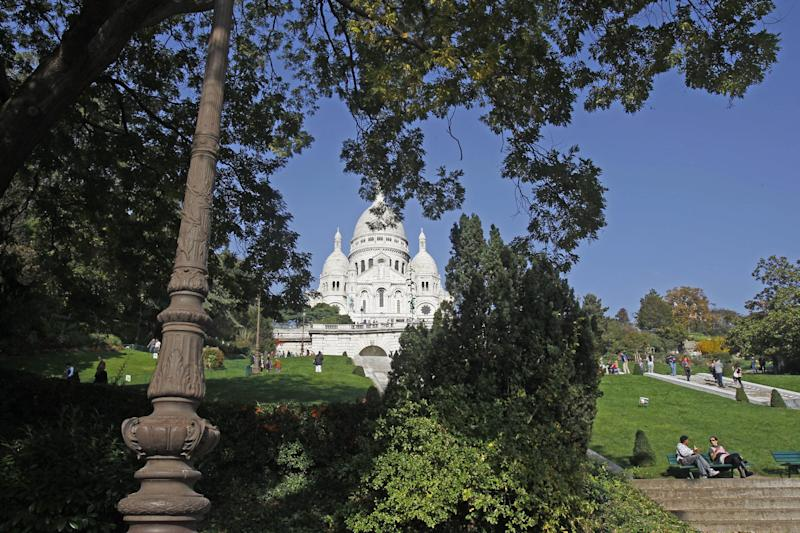 This Oct. 23, 2012 photo shows the Sacre Coeur basilica, in Paris. The landmark white domes of this basilica indelibly mark the Paris skyline, located at the city's highest point on the Montmartre hill and features the world's largest apse mosaic designed by Luc-Olivier Merson. (AP Photo/Remy de la Mauviniere)