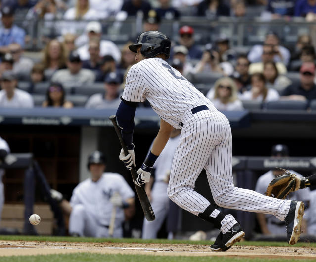 New York Yankees' Derek Jeter bunts and reaches first during the first inning of the first baseball game of a double-header against the Pittsburgh Pirates at Yankee Stadium, Sunday, May 18, 2014 in New York. (AP Photo/Seth Wenig)