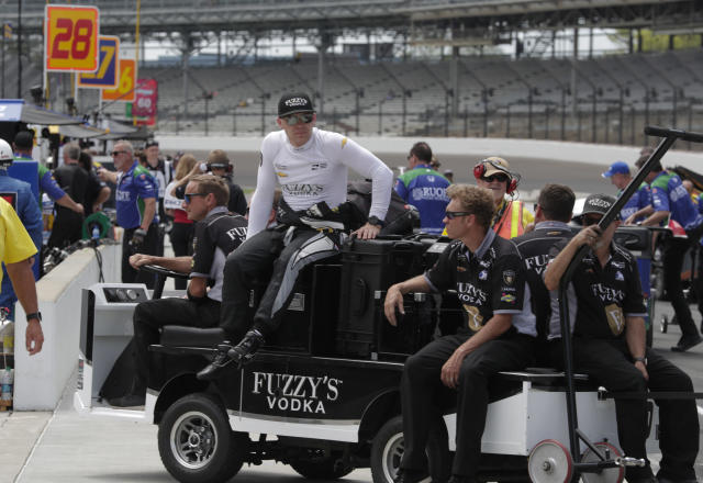 Ed Carpenter rides on the top of the team's cart as they return to the garage area during practice for the IndyCar Indianapolis 500 auto race at Indianapolis Motor Speedway, in Indianapolis Tuesday, May 15, 2018. (AP Photo/Michael Conroy)