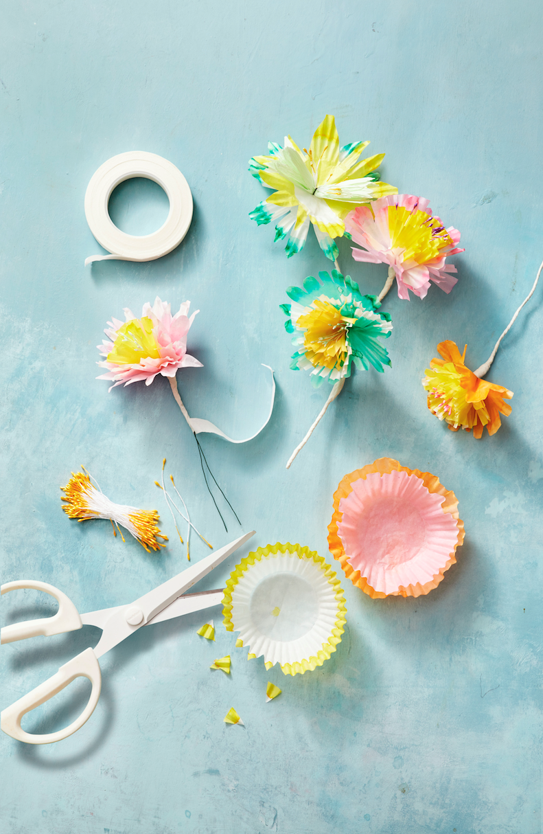 """<p>Bring spring into your home with these dainty paper blooms that will last the whole season. First, fold dyed cupcake liners (or use colored ones) in half and cut out petal and fringe shapes. Then, fold a piece of floral wire in half and twist around the faux flower stamen. Next, poke the wire through the center of three to four paper liners. Finish off by wrapping floral tape around the base of the liners and continue to wrap down the """"stem.""""<br></p><p><a class=""""link rapid-noclick-resp"""" href=""""https://www.amazon.com/Stamen-Pollen-Flower-Artificial-Scrapbook/dp/B00N6UP6MI?tag=syn-yahoo-20&ascsubtag=%5Bartid%7C10055.g.2217%5Bsrc%7Cyahoo-us"""" rel=""""nofollow noopener"""" target=""""_blank"""" data-ylk=""""slk:BUY FAUX STAMEN"""">BUY FAUX STAMEN</a> </p>"""