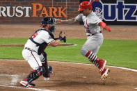Atlanta Braves catcher Francisco Cervelli (45) tags out St. Louis Cardinals second baseman Kolten Wong (16) in the eighth inning during Game 1 of a best-of-five National League Division Series, Thursday, Oct. 3, 2019, in Atlanta. (AP Photo/Scott Cunningham)