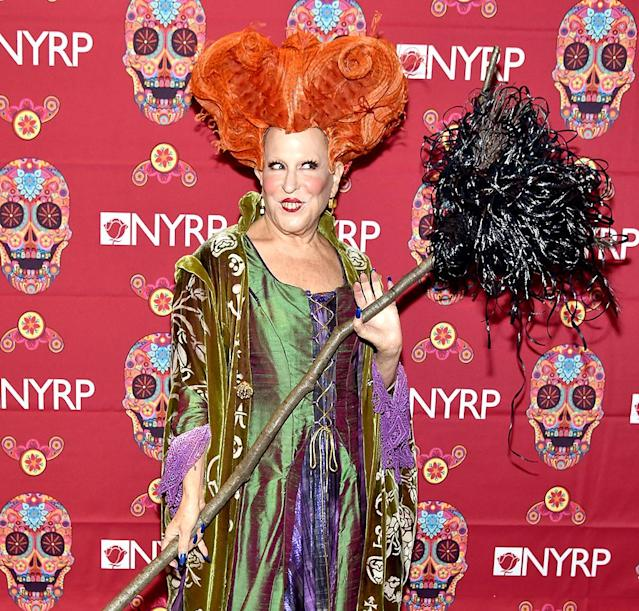 <p>The 70-year-old actress brought her <i>Hocus Pocus</i> character Winifred Sanderson back to life for her annual Hulaween Party, which raises money for New York's Restoration Project. From her voluminous red wig to her buck teeth, Midler totally nailed it. (Photo: Michael Loccisano/Getty Images) </p>