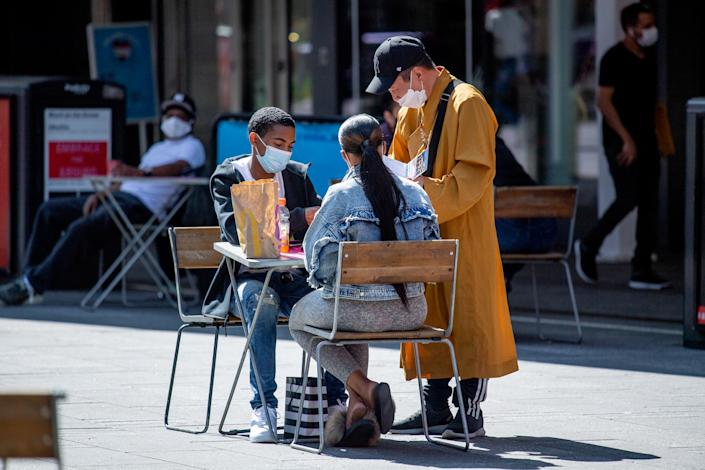 Visitors to Times Square in New York City wear masks during the fourth phase of the coronavirus reopening in Manhattan on Sept. 22. (Roy Rochlin/Getty Images)