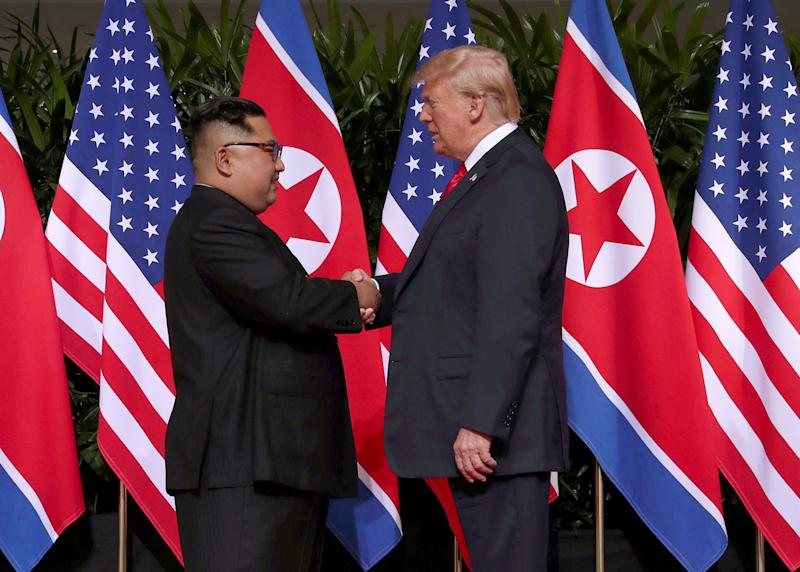 U.S. President Donald Trump shakes hands with North Korean leader Kim Jong Un at the Capella Hotel on Sentosa island in Singapore June 12, 2018. (Jonathan Ernst / Reuters)