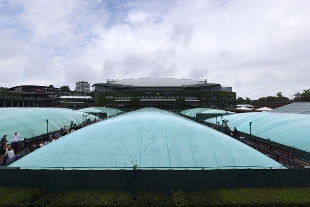 Court 10 and the outside courts are covered as rain stops play on day six of Wimbledon