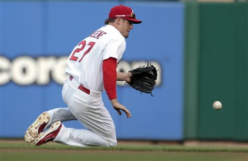 St. Louis Cardinals second baseman Tyler Greene slides to stop a ground ball hit by Atlanta Braves' Michael Bourn during the first inning of a baseball game on Saturday, May 12, 2012, in St. Louis. Bourn was safe at first with a single. (AP Photo/Jeff Roberson)