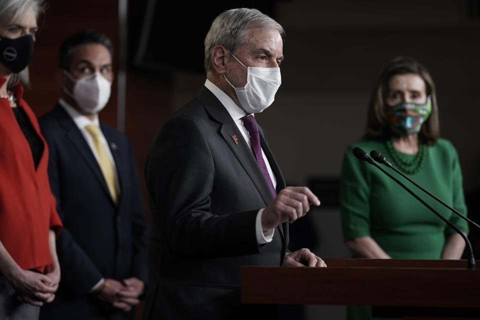 House Budget Committee Chairman John Yarmuth, D-Ky., speaks meets with reporters before the House votes to pass a $1.9 trillion pandemic relief package, during a news conference at the Capitol in Washington, Friday, Feb. 26, 2021. House Speaker Nancy Pelosi of Calif., is at right. (AP Photo/J. Scott Applewhite)