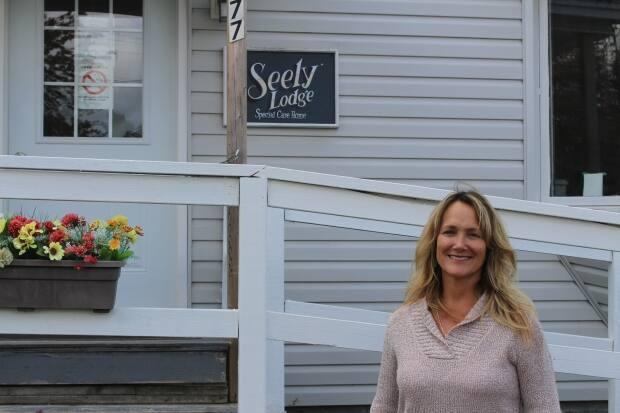 Jan Seely, seen here outside her special care home in Saint John, is pleased Public Health is considering allowing long-term care workers to get vaccinated at their local pharmacy rather than through clinics that are often much farther away.