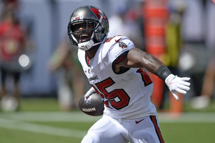 Tampa Bay Buccaneers running back Giovani Bernard (25) celebrates after his touchdown against the Miami Dolphins during the first half of an NFL football game Sunday, Oct. 10, 2021, in Tampa, Fla. (AP Photo/Jason Behnken)