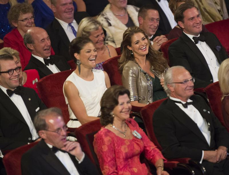 Center row from left, Sweden's Prince Daniel, Crown Princess Victoria, Princess Madeleine and Mr Christopher O'Neill sit behind Queen Silvia and King Carl Gustaf during the Swedish Riksdag's jubilee concert to celebrate the King's 40th jubilee, at the Concert Hall in Stockholm, Sweden, Saturday Sept. 14, 2013. (AP Photo/Fredrik Sandberg) SWEDEN OUT