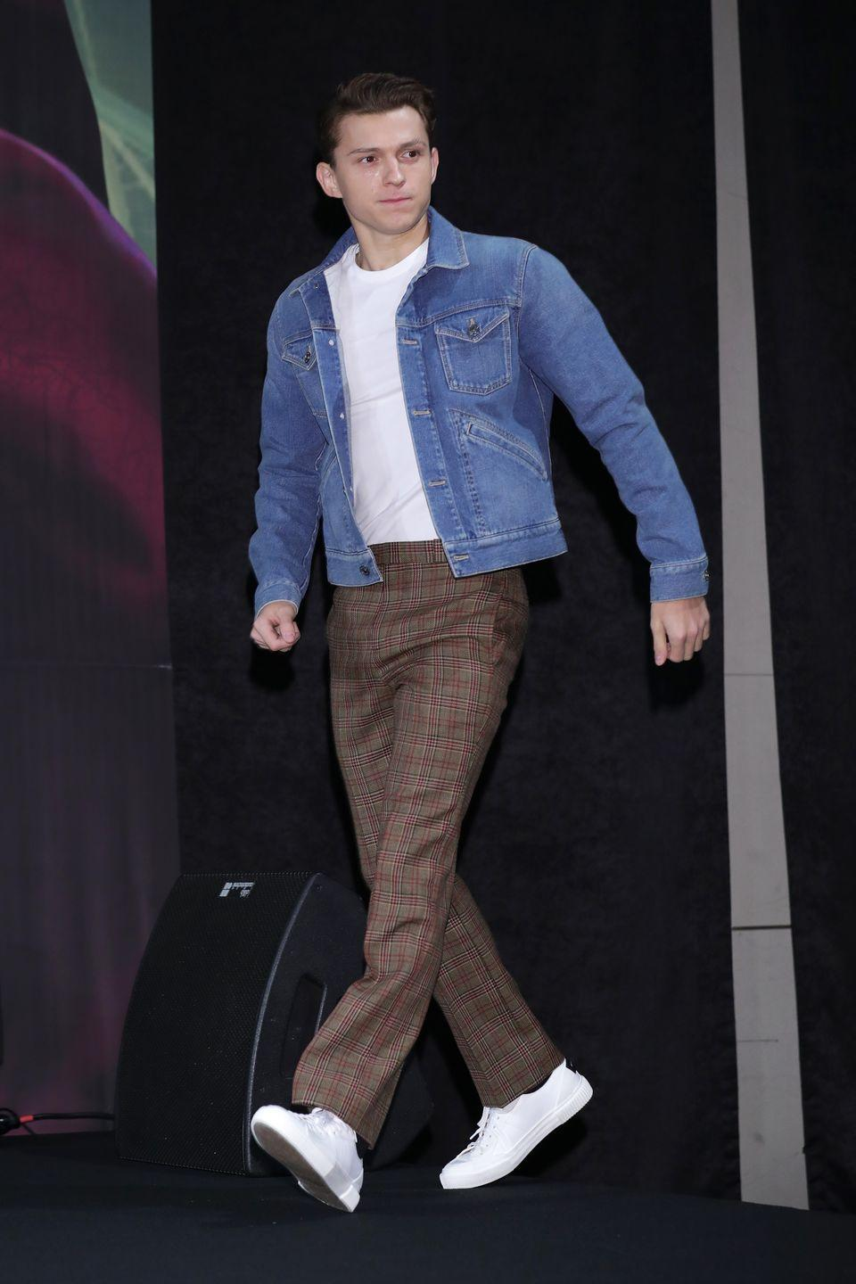 <p>The skill of high-low dressing is as much about elevating the basics as it is about toning down tailoring. Here, Holland turns a potentially tiresome casual fit into a smarter one using nothing but a pair of checked dress trousers.</p>