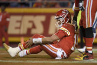 Kansas City Chiefs quarterback Patrick Mahomes holds his leg after he was tackled by Indianapolis Colts defensive ends Kemoko Turay and Justin Houston during the second half of an NFL football game in Kansas City, Mo., Sunday, Oct. 6, 2019. (AP Photo/Reed Hoffmann)