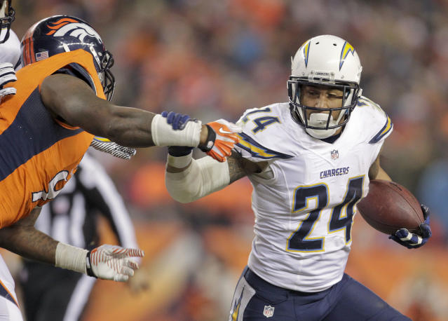 San Diego Chargers running back Ryan Mathews (24) brushes off Denver Broncos defensive end Robert Ayers (91) in the second quarter of an NFL football game, Thursday, Dec. 12, 2013, in Denver. (AP Photo/Joe Mahoney)
