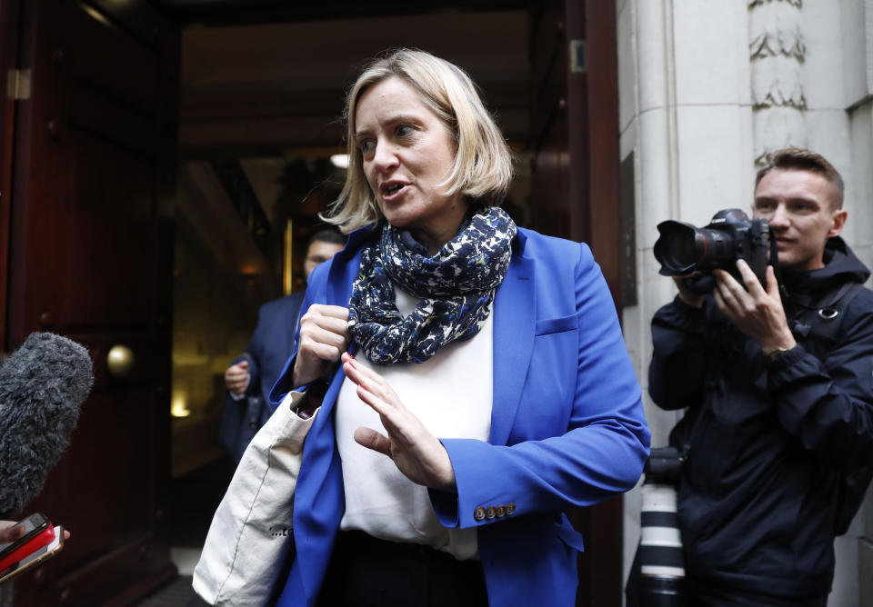 British Conservative Party lawmaker Amber Rudd speaks to the media in London, Tuesday, Sept. 24, 2019. In a decision with wide-ranging political ramifications, Britain's Supreme Court plans to give its verdict Tuesday on the legality of Prime Minister Boris Johnson's five-week suspension of Parliament. (AP Photo/Alastair Grant)