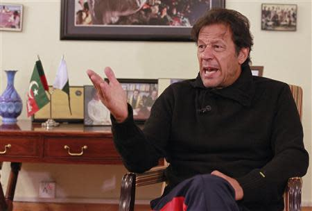 Khan, chairman of the Pakistan Tehreek-e-Insaf, speaks during an interview with Reuters in Islamabad