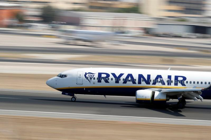 FILE PHOTO: A Ryanair Boeing 737 plane lands at Lisbon's airport