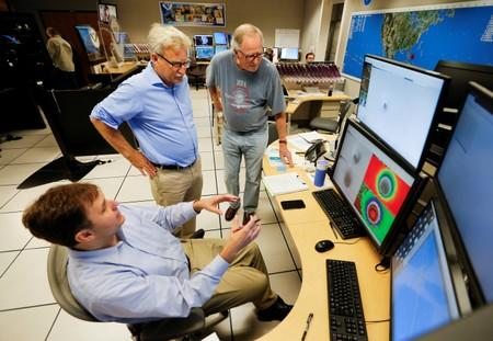 Hurricane Specialist Eric Blake confers with Branch Chief of Technology and Science Mark De Maria and Hurricane Researcher Dr Peter Black at the National Hurricane Center ahead of the arrival of Hurricane Dorian in Miami