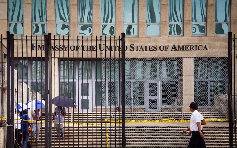 "A photo of the U.S. embassy in Havana taken on Sept. 29, 2017, after the U.S. announced its <a href=""https://www.straitstimes.com/world/united-states/us-orders-60-per-cent-of-its-staff-to-leave-cuban-embassy-over-specific-attacks"" target=""_blank"" rel=""noopener noreferrer"">withdrawal of more than half its personnel</a> in response to mysterious health attacks targeting diplomatic staff. (AFP/Getty Images)"