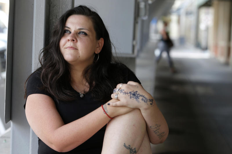 Former Fluvanna Correctional Center for Women inmate Stephanie Parris sits in Market Square on Wednesday, July 15, 2020, in Roanoke, Va. Parris was finishing a two-year prison sentence for a probation violation when she heard she'd be going home three weeks early because of COVID-19. (AP Photo/Steve Helber)