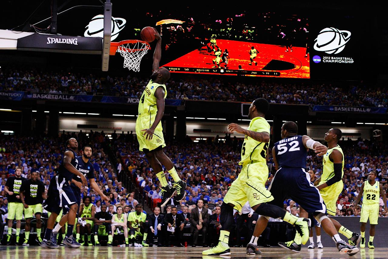 ATLANTA, GA - MARCH 23:  Quincy Acy #4 of the Baylor Bears dunks against the Xavier Musketeers in the second half during the 2012 NCAA Men's Basketball South Regional Semifinal game at the Georgia Dome on March 23, 2012 in Atlanta, Georgia.  (Photo by Streeter Lecka/Getty Images)