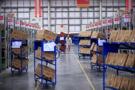 An employee works at a Tmall logistic centre in Suzhou