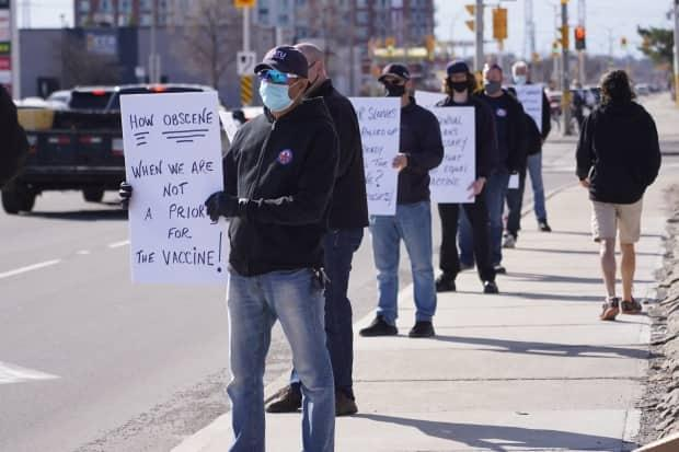 Ottawa transit workers protest for early access to the COVID-19 vaccine on April 12, 2021.