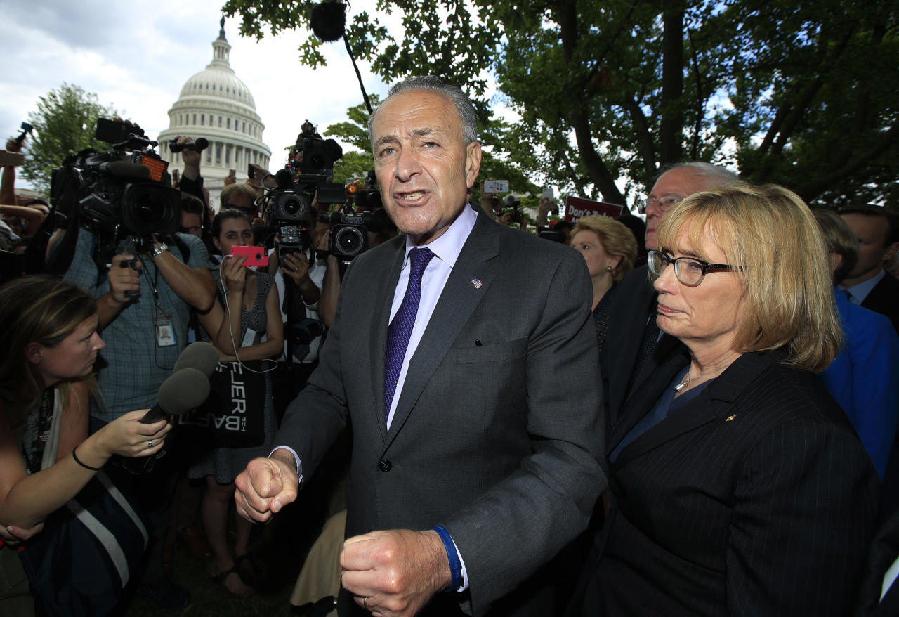 Senate Minority Leader Chuck Schumer of N.Y., together with other Democratic Senators, from second from left, Sen. Debbie Stabenow, D-Mich., Sen. Bernie Sanders, I-Vt., and Sen. Maggie Hassan, D-N.H., speaks to supporters outside the Capitol in Washington, Tuesday, July 25, 2017, after the Senate voted to start debating Republican legislation to tear down much of the Obama health care law. (AP Photo/Manuel Balce Ceneta)