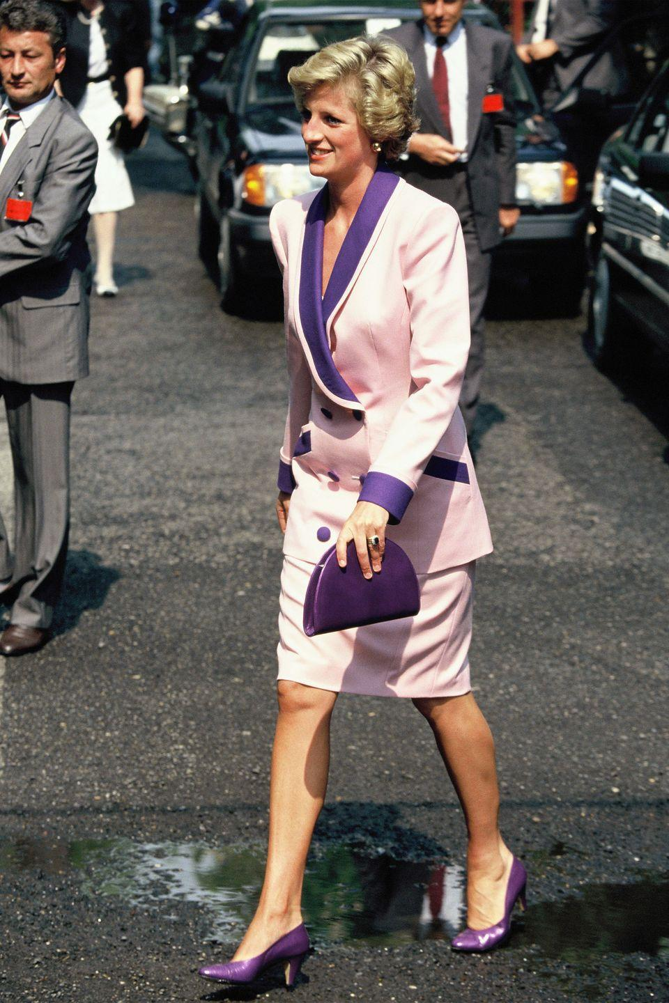 <p>In a pink-and-purple suit with matching purple shoes and clutch on an official visit to Hungary. </p>