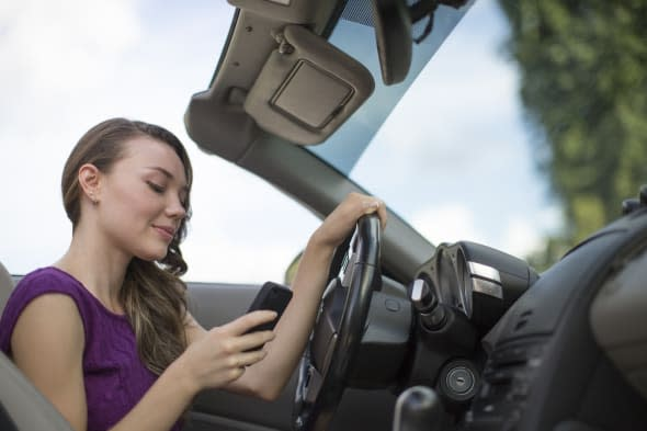 Woman texting while driving