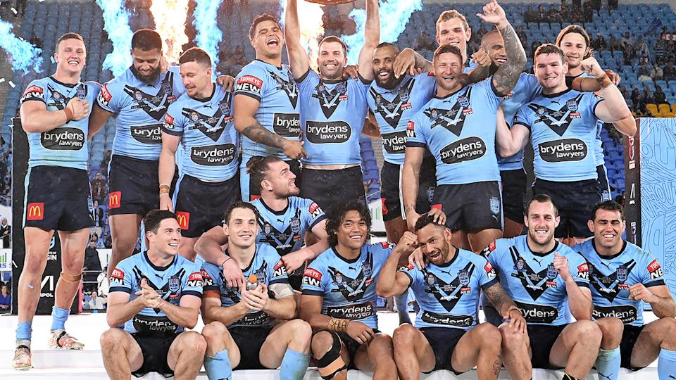 James Tedesco, pictured here holding aloft the Origin shield with his NSW teammates.