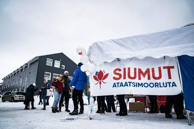Candidates from the Greenlandic party Siumut pass out flyers in Nuuk in Greenland, Wednesday. The autonomous territory within the Kingdom of Denmark, Greenland, will hold election to its Parliament consisting of 31 members, on April 6. (Emil Helms/Ritzau Scanpix via AP - image credit)