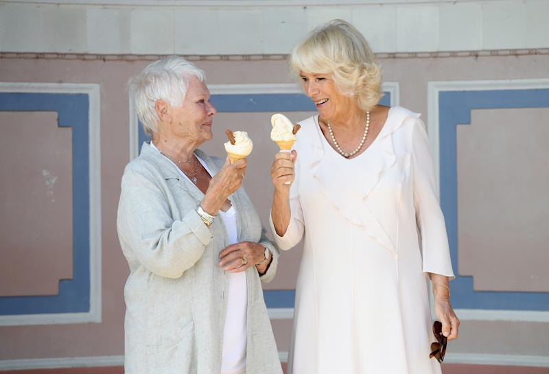 Camilla Parker Bowles eating ice cream with Dame Judi Dench at the Queen Victoria's private beach in East Cowes, Isle of Wight, England, July 2018.