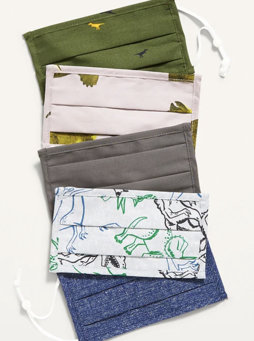 The best face masks for kids in Canada: Variety 5-Pack of Triple-Layer Cloth Pleated Face Masks in Green Dinosaurs (Photo via Old Navy)