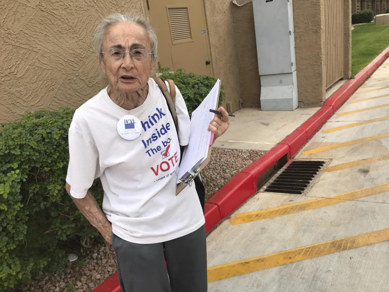 FILE - In this April 19, 2018 file photo, Rivko Knox, a volunteer with the League of Women Voters, collects signatures for a campaign financing ballot measure outside a polling station in Glendale, Ariz. A judge on Friday, Aug. 24, 2018 upheld a 2016 Arizona law that bans groups from collecting early mail-in ballots from voters and delivering them. The ruling dismissed a legal challenge to the law filed by Knox. (AP Photo/Anita Snow, File)