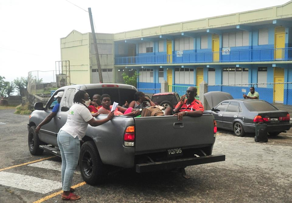 A NEMO (National Emergency Management Organisation of St Vincent and the Grenadines) official ensures all evacuees are safe before giving approval to the driver to depart following the eruption of La Soufriere volcano on the eastern Caribbean island of St Vincent.