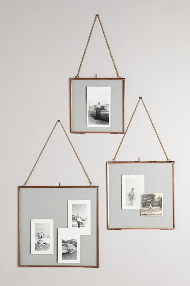 """<p><strong>Buy It: from $28;<i> </i></strong><a href=""""https://click.linksynergy.com/deeplink?id=93xLBvPhAeE&mid=39789&murl=https%3A%2F%2Fwww.anthropologie.com%2Fshop%2Fviteri-hanging-frame&u1=SL%2CRX_1910_Updated_GiftsforBestFriends_AnthropologieFrame%2Csimsj%2C%2CIMA%2C245979%2C201910%2CI"""" target=""""_blank"""">anthropologie.com</a><strong><a href=""""http://click.linksynergy.com/fs-bin/click?id=93xLBvPhAeE&subid=0&offerid=460756.1&type=10&tmpid=16681&RD_PARM1=https%3A%2F%2Fwww.anthropologie.com%2Fshop%2Fhinged-hanging-picture-frame2&u1=SLGGBestFriendJSNov"""" target=""""_blank""""> </a></strong></p> <p> These frames are not only sleek and stylish, but so easy to personalize—just add a favorite photo and wrap!</p>"""