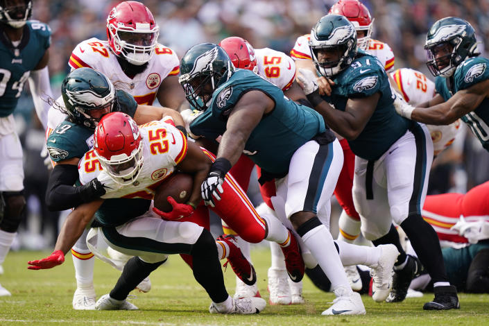 Kansas City Chiefs running back Clyde Edwards-Helaire (25) is brought down by Philadelphia Eagles linebacker Alex Singleton (49) during the second half of an NFL football game Sunday, Oct. 3, 2021, in Philadelphia. (AP Photo/Matt Rourke)